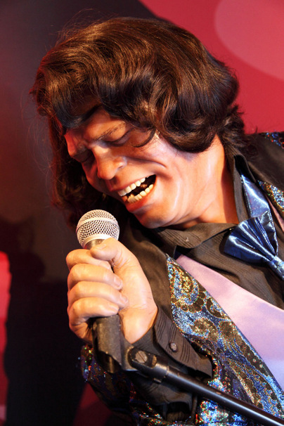 James Brown wax figure singing with microphone